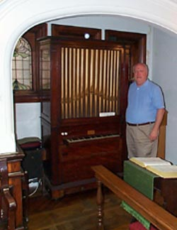 Larry by the Charles Wesley organ at the Wesley Chapel in London.